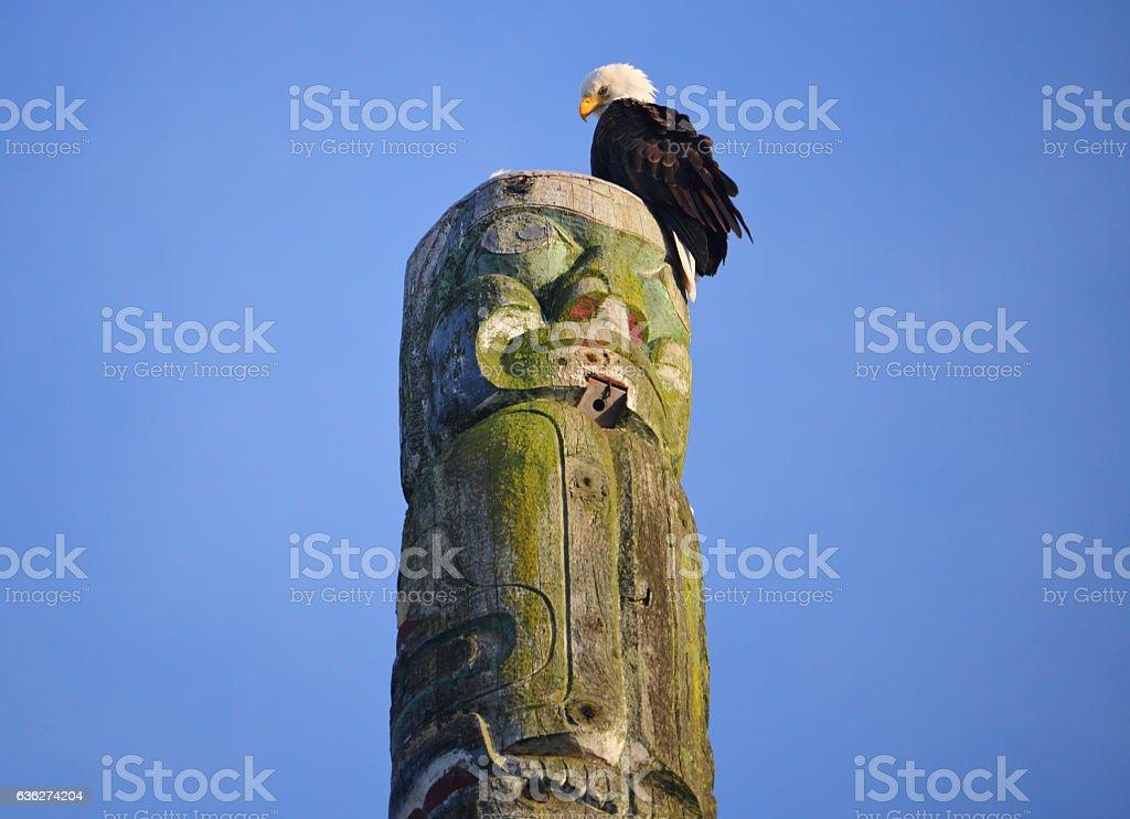 Adult Eagle on a Canadian Totem Pole stock photo