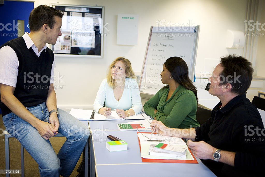 adult education: class study with mature learners stock photo