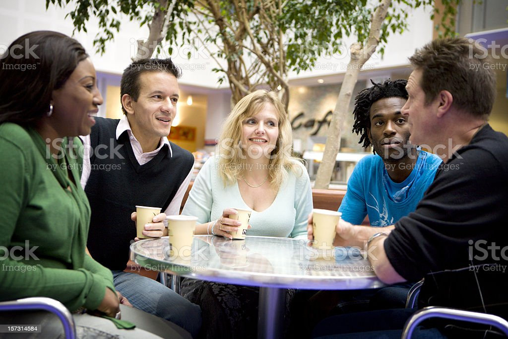 adult education: diverse mature adults taking a break together royalty-free stock photo