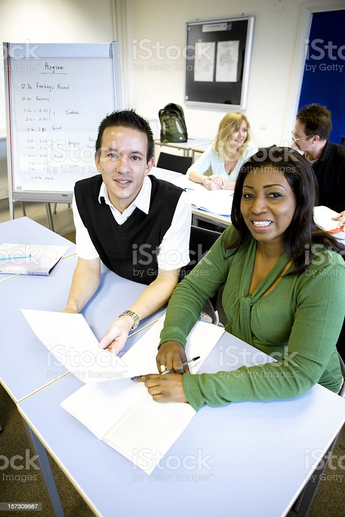 adult education: diverse mature students with bright smile in class stock photo