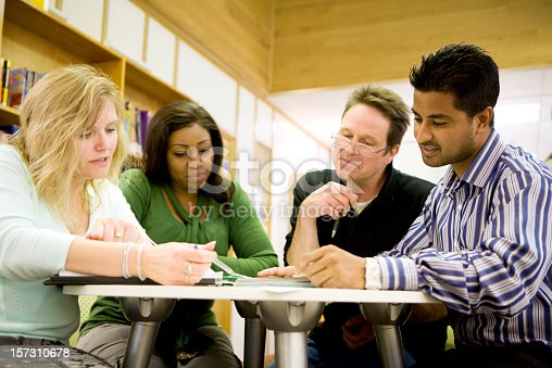 istock adult education: Diverse mature students working in their college library 157310678