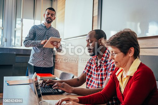 876965270 istock photo Adult education for diverse group of mature adults 1062424344