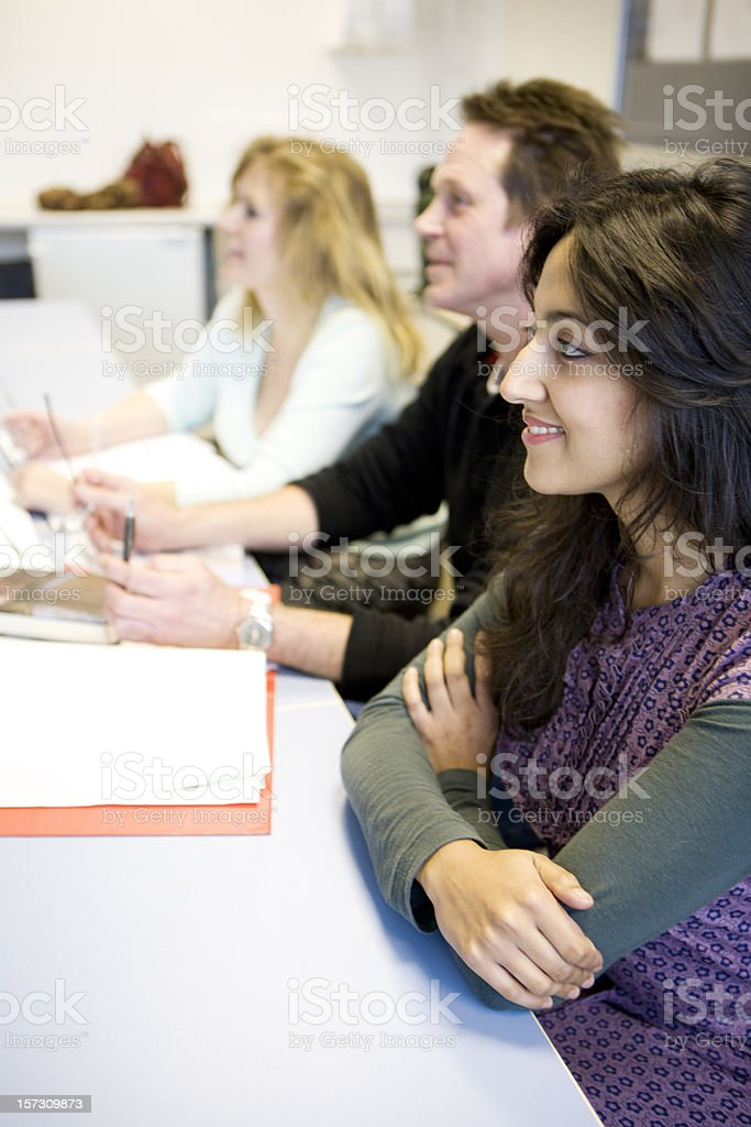 adult education: keen and attentive class of mature diverse students royalty-free stock photo