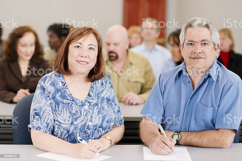 Adult education: large diverse group of mature people in training royalty-free stock photo