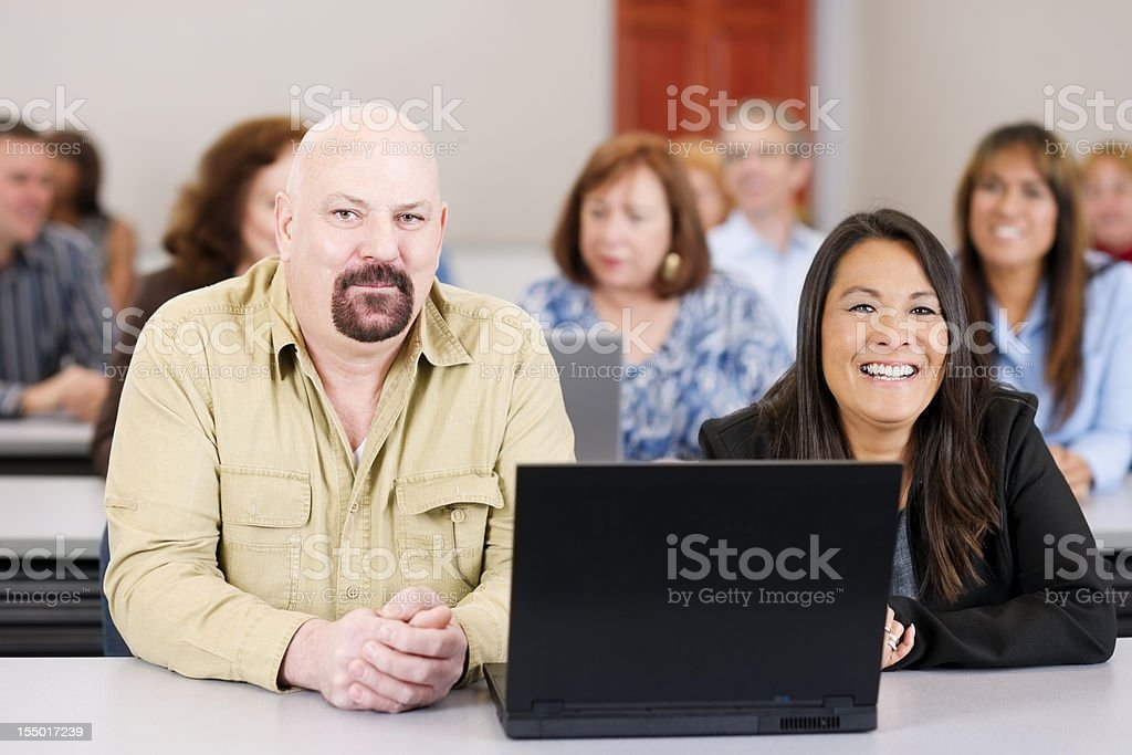 Adult education: large diverse group of smiling people in training royalty-free stock photo