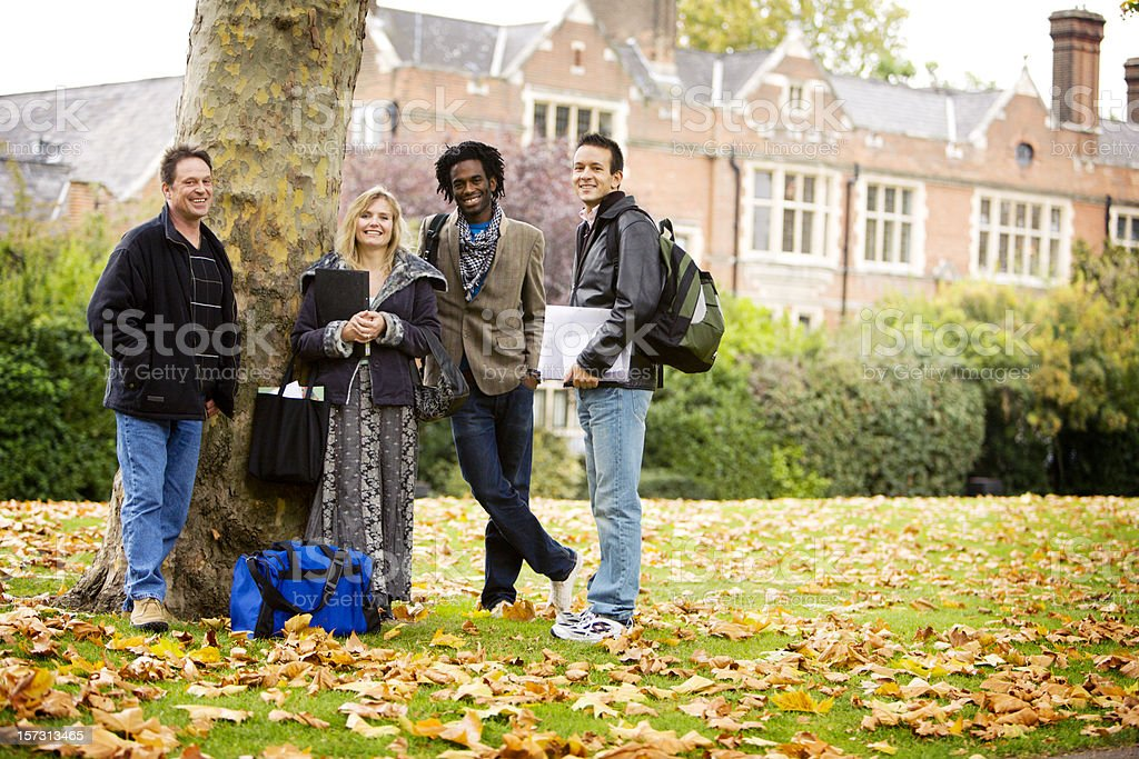 adult education: mature learners during a break from class stock photo