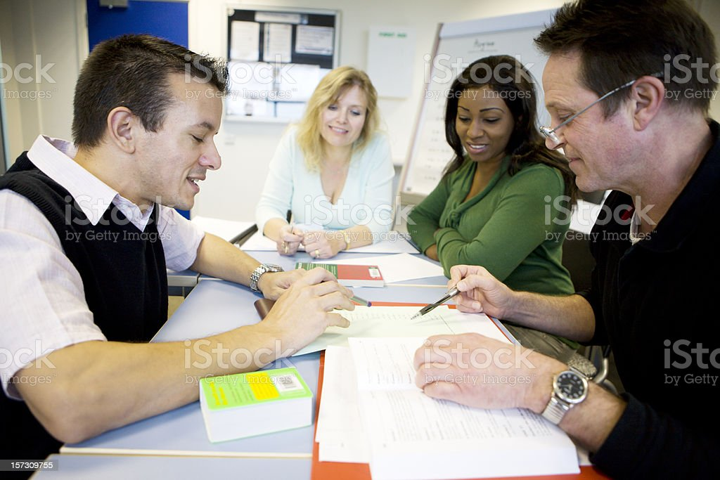 adult education: mature students working together in the classroom royalty-free stock photo