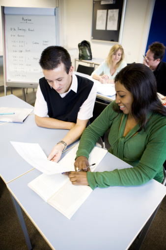 istock adult education: mature students working together in the classroom 157394264