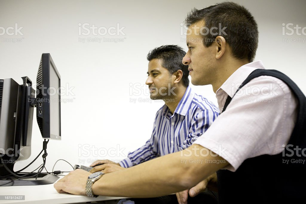 adult education: mature students working together on a project royalty-free stock photo