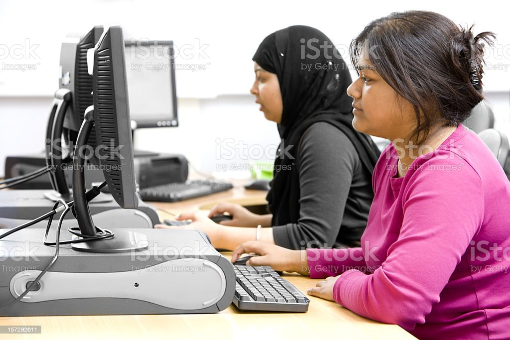 adult education: South Asian students researching online for class royalty-free stock photo