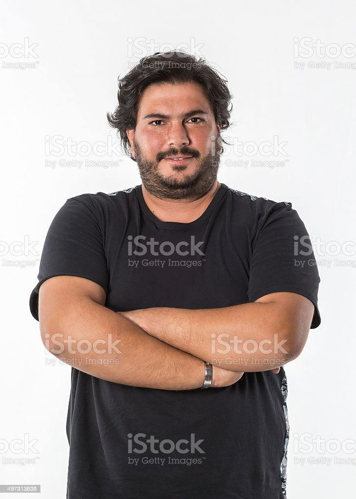 adult fat man arms crossed stock photo