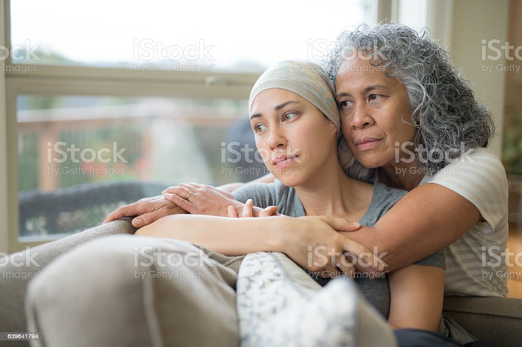 Adult female with cancer being nurtured by her mature mother stock photo