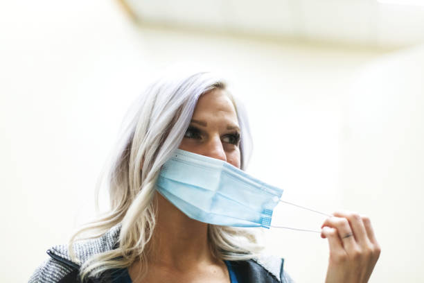 Adult Female with Protective Face Mask During Pandemic Photo Series In Western Colorado Adult Female with Protective Face Mask During Pandemic Photo Series Matching 4K Video Available (Shot with Canon 5DS 50.6mp photos professionally retouched - Lightroom / Photoshop - original size 5792 x 8688 downsampled as needed for clarity and select focus used for dramatic effect) eyecrave stock pictures, royalty-free photos & images