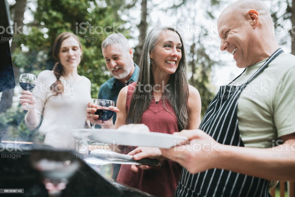 Adult Friends Wine and BBQ stock photo
