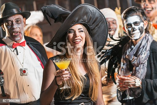 istock Adult halloween party, witch drinking 827366086