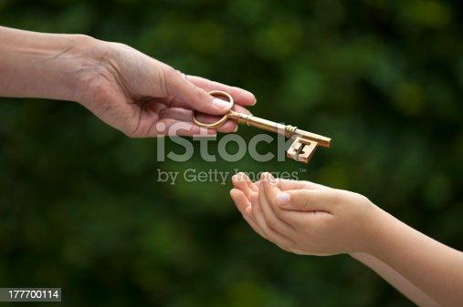 mother handing key to daughter