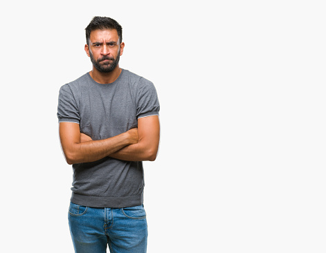 istock Adult hispanic man over isolated background skeptic and nervous, disapproving expression on face with crossed arms. Negative person. 1042827684
