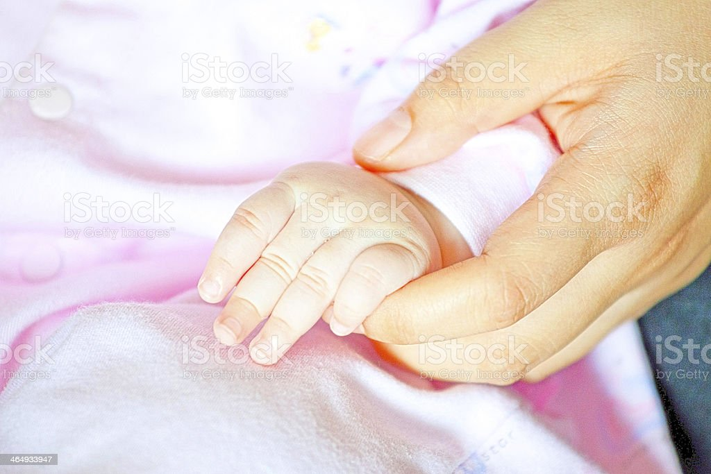 Adult holding a baby hand royalty-free stock photo