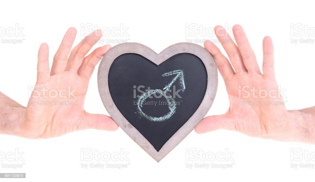 Yetişkin kalp tutan kara tahta - erkek şeklinde. - Royalty-free Ahşap Stok görsel