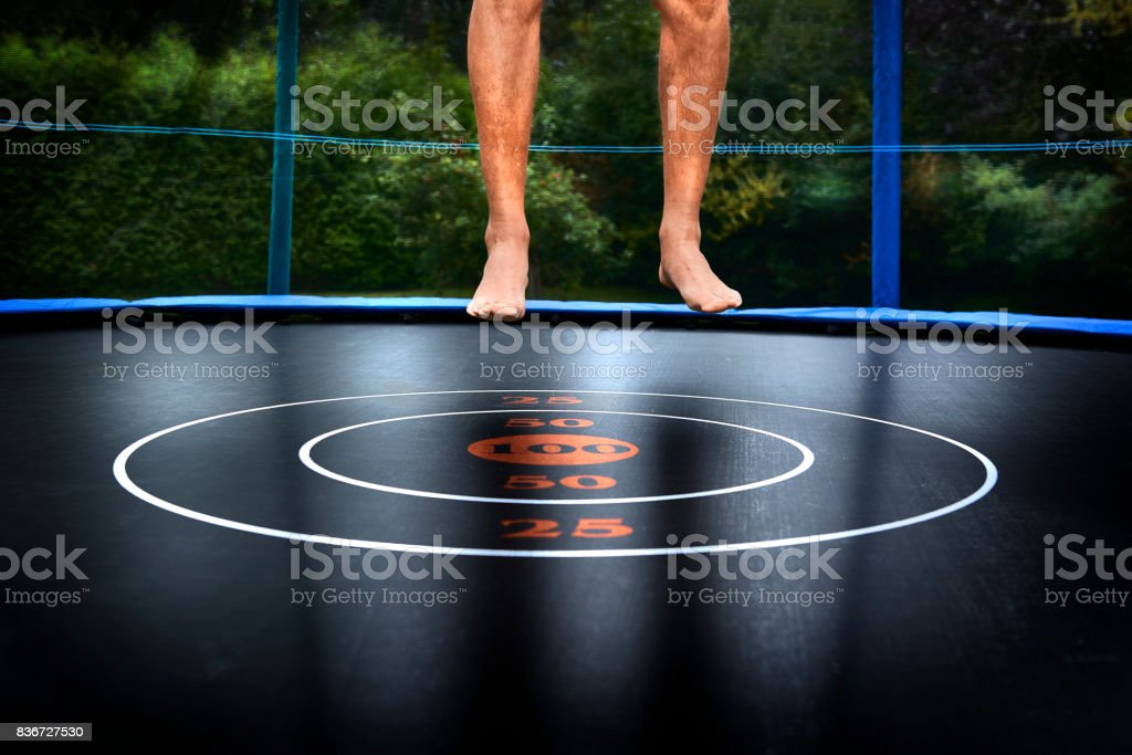 Adult jumping on trampoline stock photo