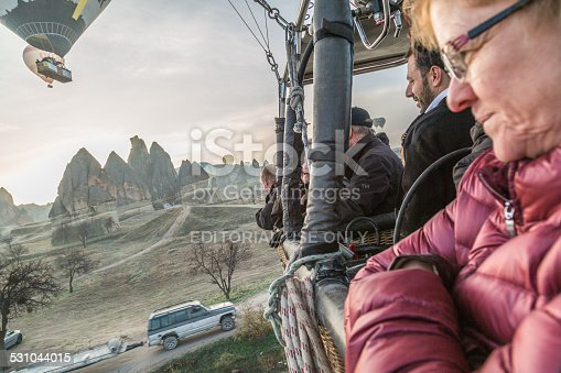 istock adult lady in a balloon gondola 531044015