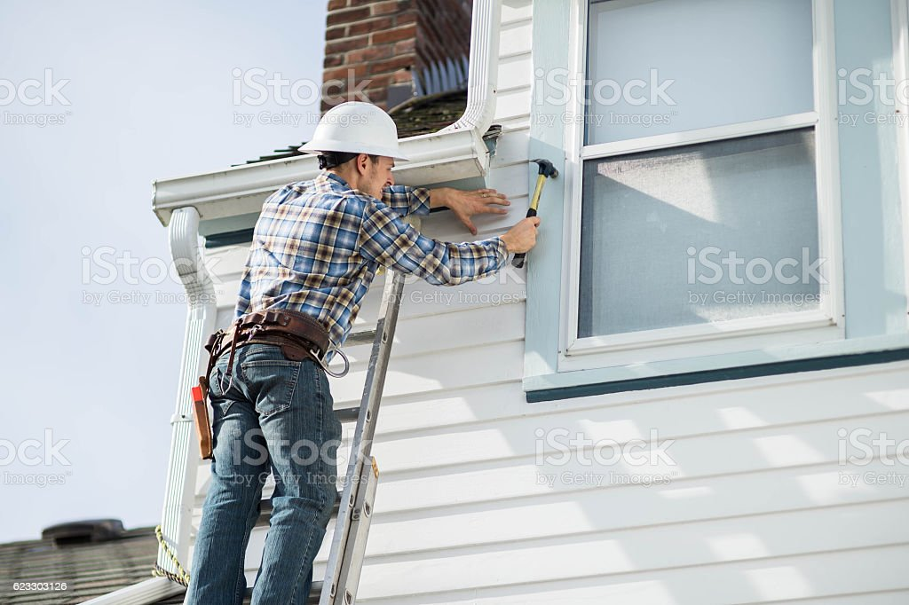 Adult male construction worker working on residence stock photo
