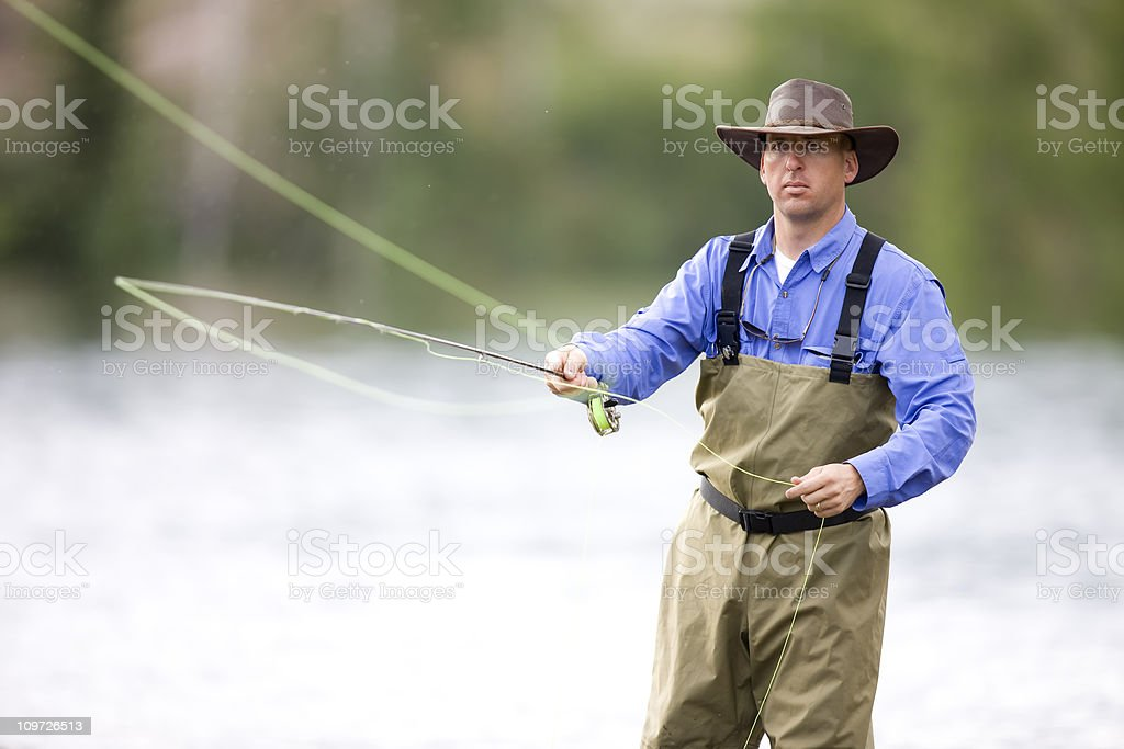 Adult Male Fly Fisher Casting royalty-free stock photo