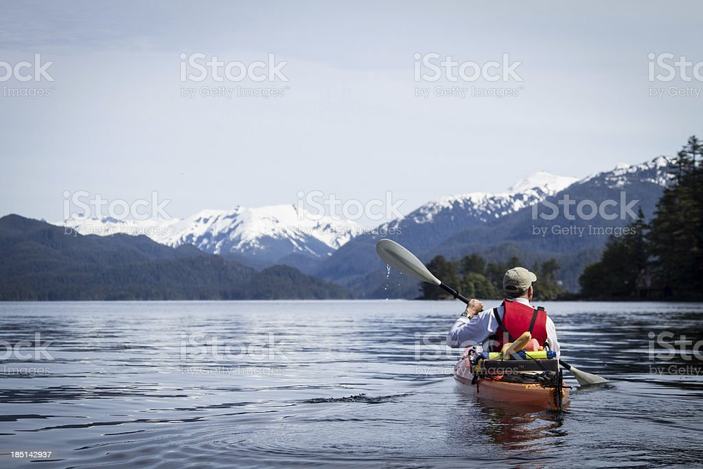 Adult Male Kayaking in Sitka Harbor Alaska stock photo