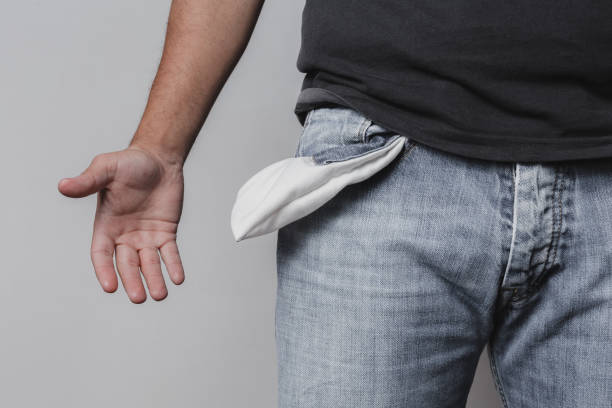 adult male showing his empty pockets stock photo