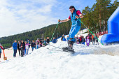 BELORETSK,RUSSIA, 13 APRIL 2019 - \n adult male skier makes a jump on a ski jump on a ski slope in the Ural mountains