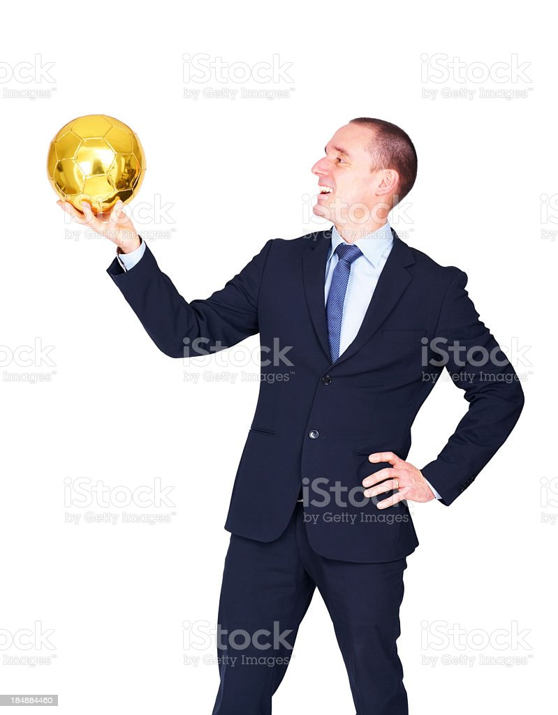 Adult male team manager looking at a golden football stock photo