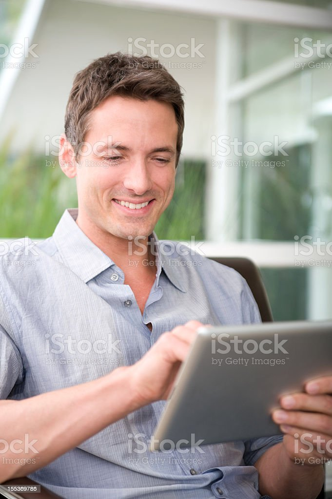 Adult male using a digital tablet royalty-free stock photo