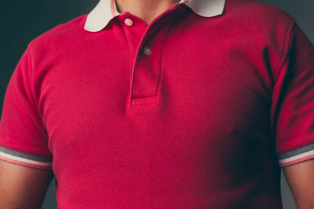 Adult male wearing a red polo shirt stock photo
