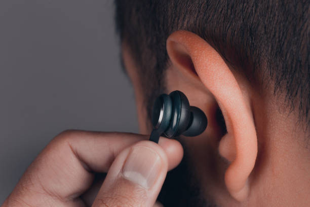 adult male with earphones in the ear stock photo