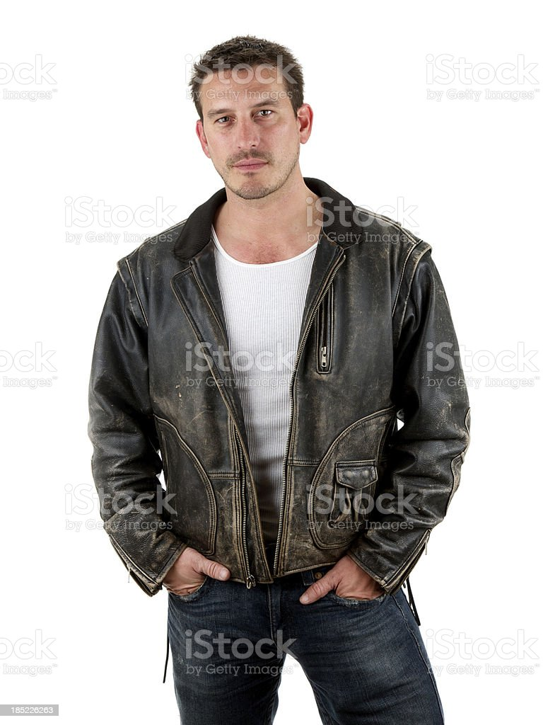 Adult male with serious expression wearing leather stock photo