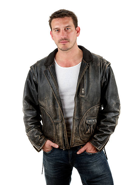 Adult male with serious expression wearing leather Please view more photos of this adult male! leather jacket stock pictures, royalty-free photos & images