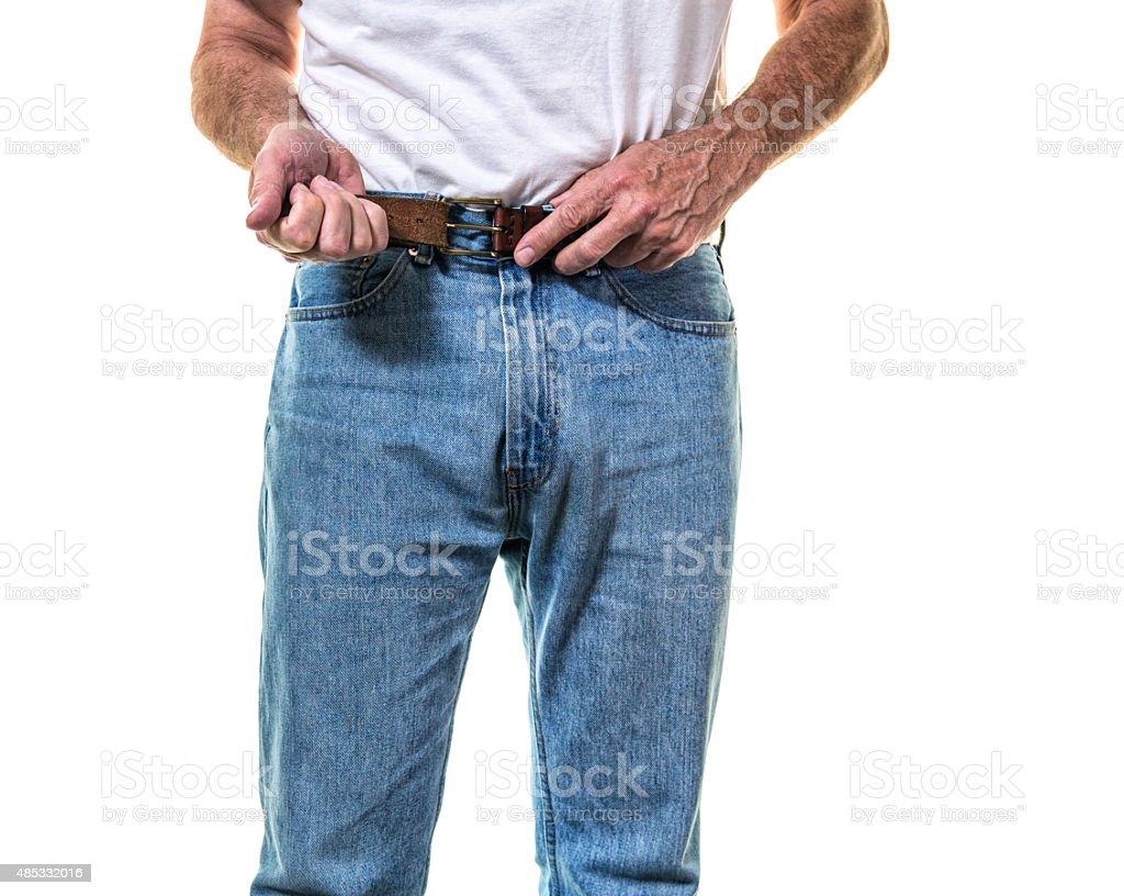 Adult Man Buckling Belt Getting Dressed stock photo