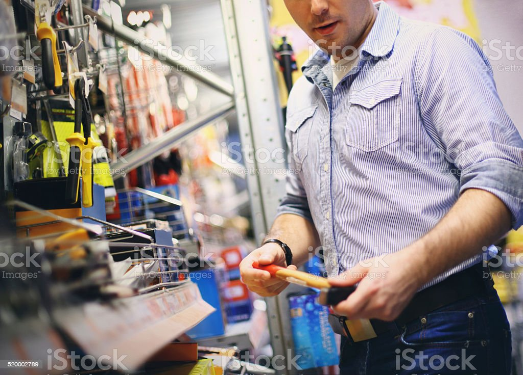 Adult man buying tools in hardware store. stock photo