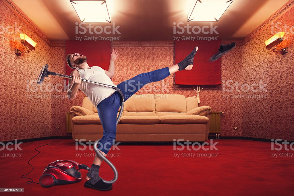 Adult man dancing withvacuum cleaner stock photo