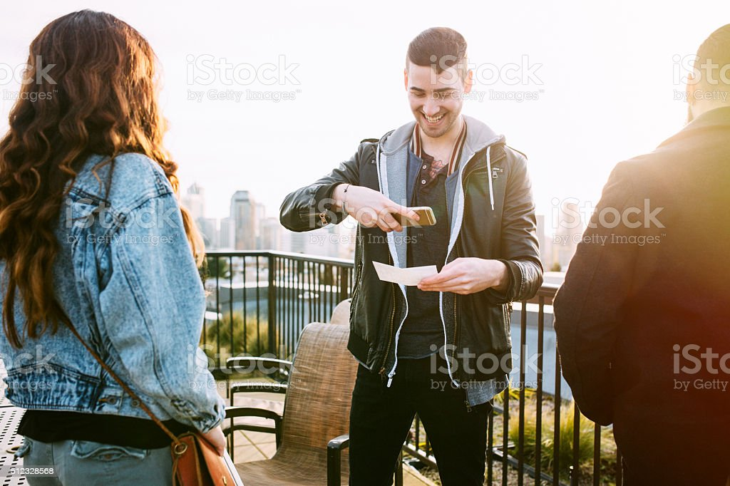 Adult Man Depositing Check with Smart Phone stock photo