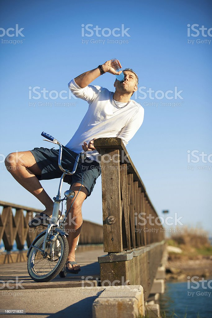 Adult man drinking an energy drink royalty-free stock photo