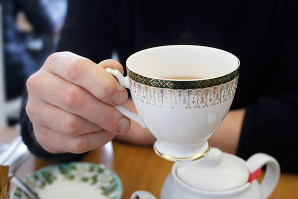 adult man drinking hot tea - jasmin party stock-fotos und bilder
