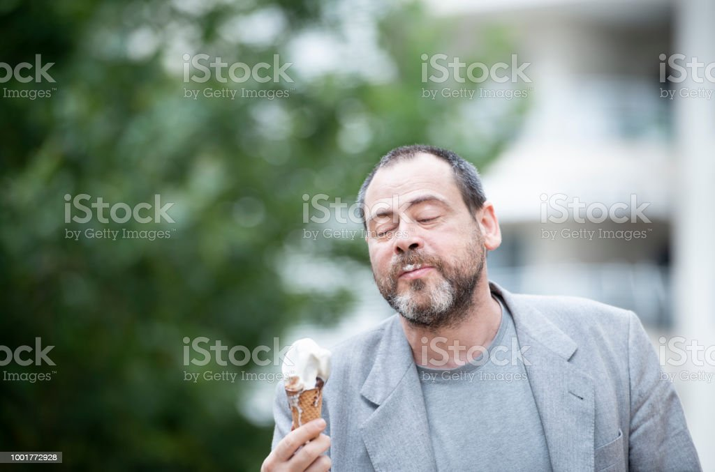 Adult Man Eating an Ice Cream - foto stock