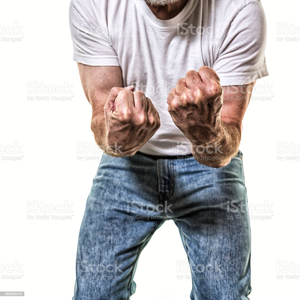 Adult Man Fighter Showing Clenched Fists to Camera stock photo