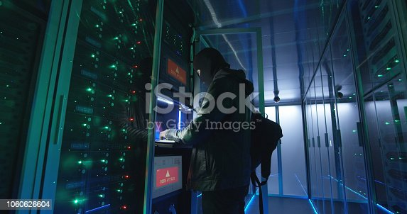 istock Adult man hacking servers with computer 1060626604