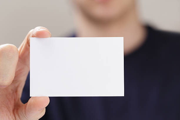 Royalty free man holding business card pictures images and stock adult man hand holding empty business card stock photo reheart Choice Image
