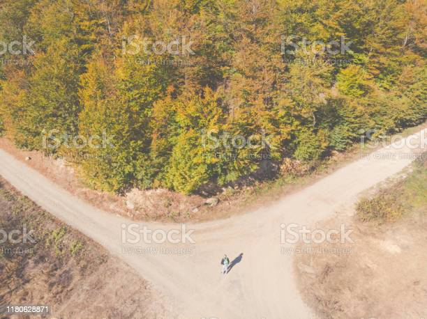 Photo of Adult man hiker hiking at mountains on beautiful indian summer day