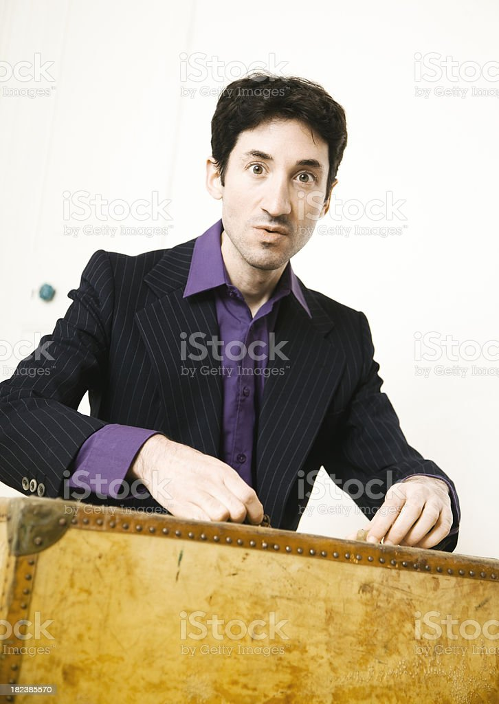 Adult man holding old suitcase stock photo