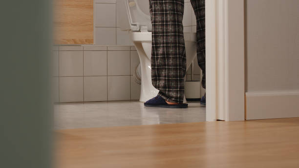 Adult man in a toilet at home Adult man in a toilet at home prostate gland stock pictures, royalty-free photos & images