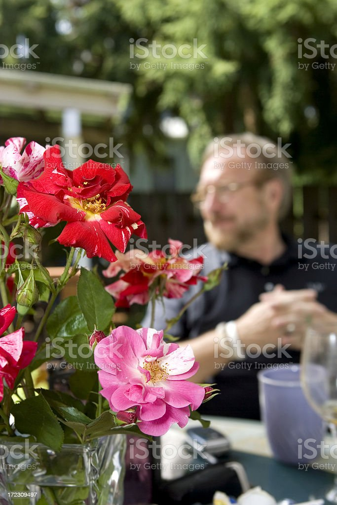 Adult Man in Background, Beautiful Sunny Day on Patio, Copyspace stock photo